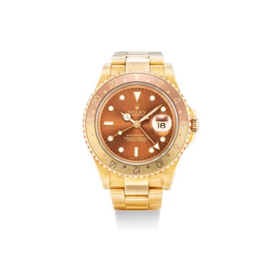 View 1. Thumbnail of Lot 101. ROLEX | GMT-MASTER II, REFERENCE 16718, A YELLOW GOLD WRISTWATCH WITH DATE AND BRACELET, CIRCA 1993.