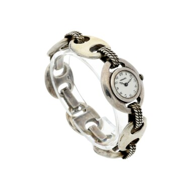 View 3. Thumbnail of Lot 238. RETAILED BY HERMES: A LADY'S STERLING SILVER BRACELET WATCH, CIRCA 1955.