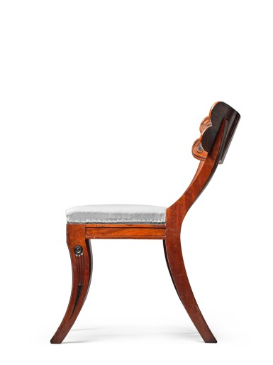 View 2. Thumbnail of Lot 158. A set of twelve Regency mahogany and ebony 'Klismos' dining chairs, circa 1815, after a design by Thomas Hope.