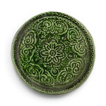 A RARE GREEN-GLAZED MOULDED AND INCISED BOX AND COVER, TANG DYNASTY | 唐 綠釉印花小蓋盒