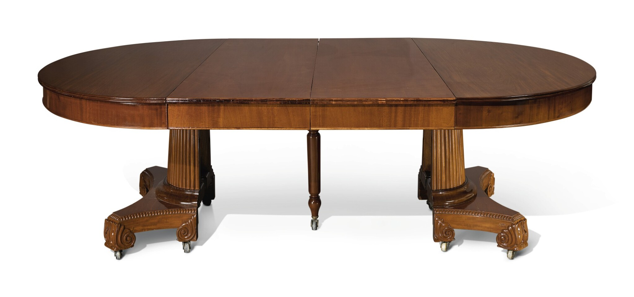 View full screen - View 1 of Lot 283. A CONTINENTAL NEOCLASSICAL MAHOGANY DINING TABLE, 19TH CENTURY .