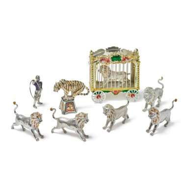 LIONS: A GROUP OF SILVER AND ENAMEL CIRCUS FIGURES, DESIGNED BY GENE MOORE FOR TIFFANY & CO., NEW YORK, CIRCA 1990