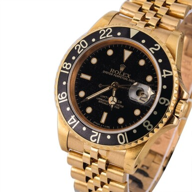 View 1. Thumbnail of Lot 8. ROLEX | GMT-Master, Ref. 16758, A Yellow Gold Wristwatch with Bracelet Circa 1981.