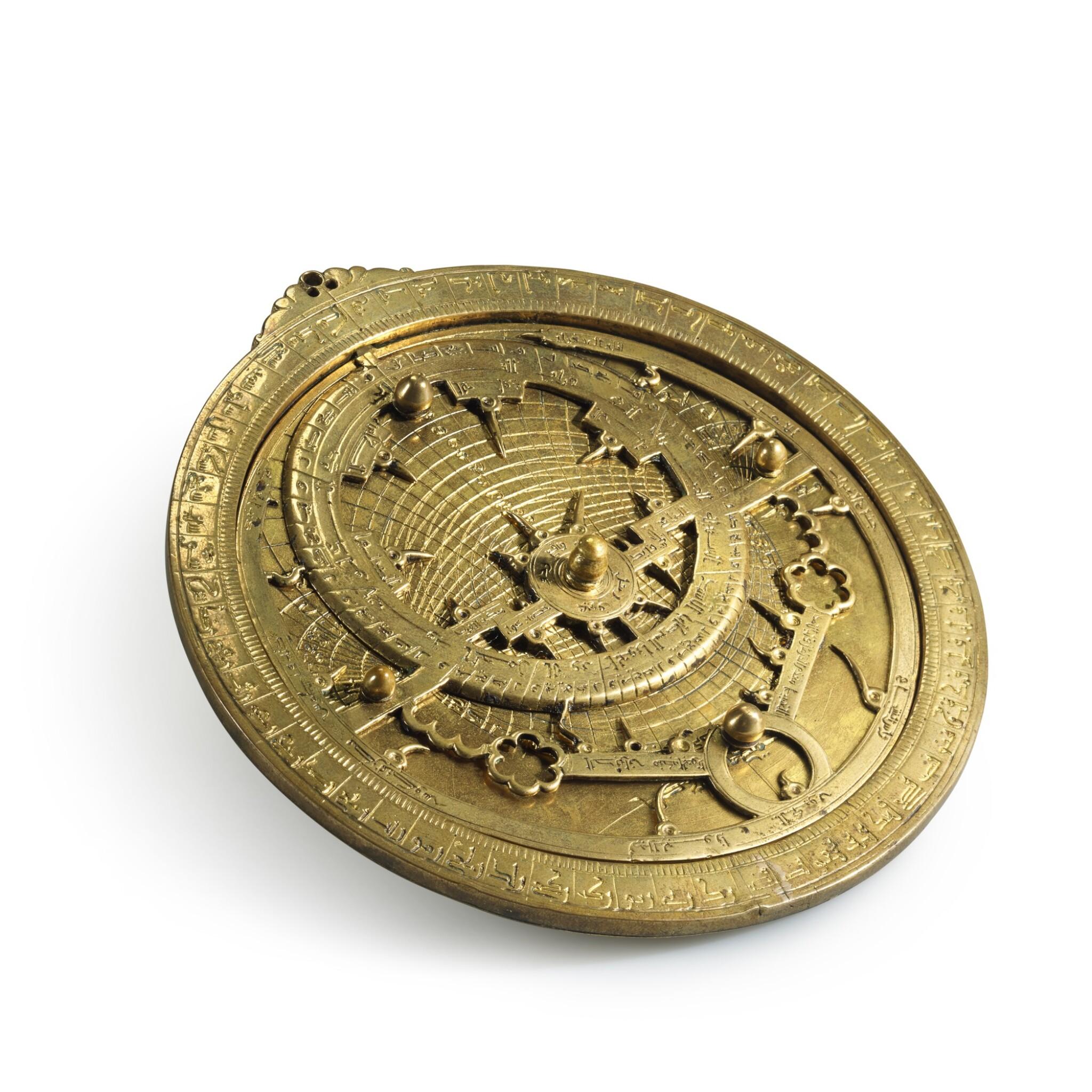 View full screen - View 1 of Lot 66. A gilt-brass astrolabe signed by Ahmad ibn Abu 'Abdallah al-Qurtubi al-Yamani, North-East Spain, Tudela, dated 737 AH/1336-37 AD.