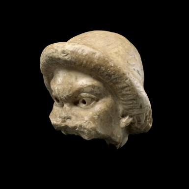 View 2. Thumbnail of Lot 104. A Fragmentary Roman Marble Theater Mask, circa 2nd Century A.D..
