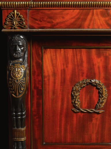 View 2. Thumbnail of Lot 28. A late George III gilt-bronze mounted mahogany library bookcase incorporating a concealed door, circa 1805-10, attributed to Marsh and Tatham after designs by Thomas Hope.