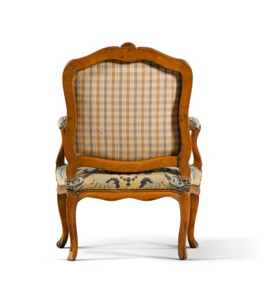 View 4. Thumbnail of Lot 79. A pair of Louis XV carved beechwood fauteuils à la reine, one mid-18th century, the other a later copy.