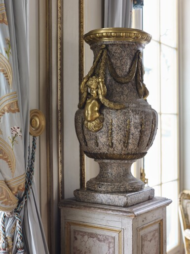 View 9. Thumbnail of Lot 57. A Monumental Pair of Gilt Bronze-Mounted Pink Granite Vases, the Mounts Circa 1840 After Designs by Jean-Louis Prieur or Jean-François Forty; the Vases Possibly Late 18th Century.