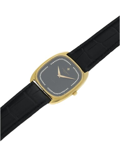 View 6. Thumbnail of Lot 804. REFERENCE 44003 A YELLOW GOLD CUSHION SHAPED AUTOMATIC WRISTWATCH WITH DIAMOND-SET ONYX DIAL, CIRCA 1985.