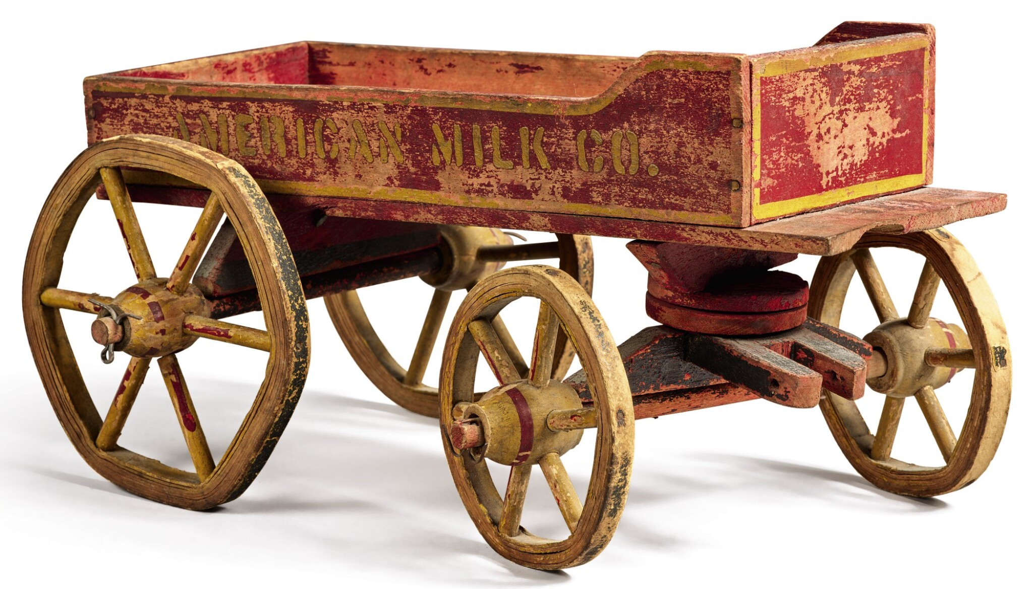 View full screen - View 1 of Lot 1496.  'AMERICAN MILK COMPANY' PAINTED WOOD AND WIRE CHILDREN'S PULL-TOY WAGON, EARLY 20TH CENTURY.