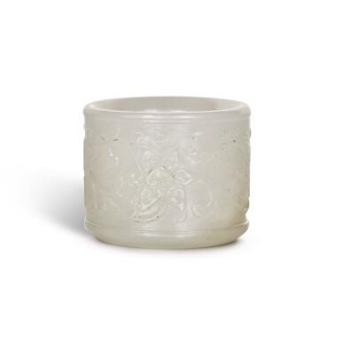 A WHITE JADE THUMB RING, QING DYNASTY, 18TH CENTURY   清十八世紀 白玉纏枝蓮紋扳指