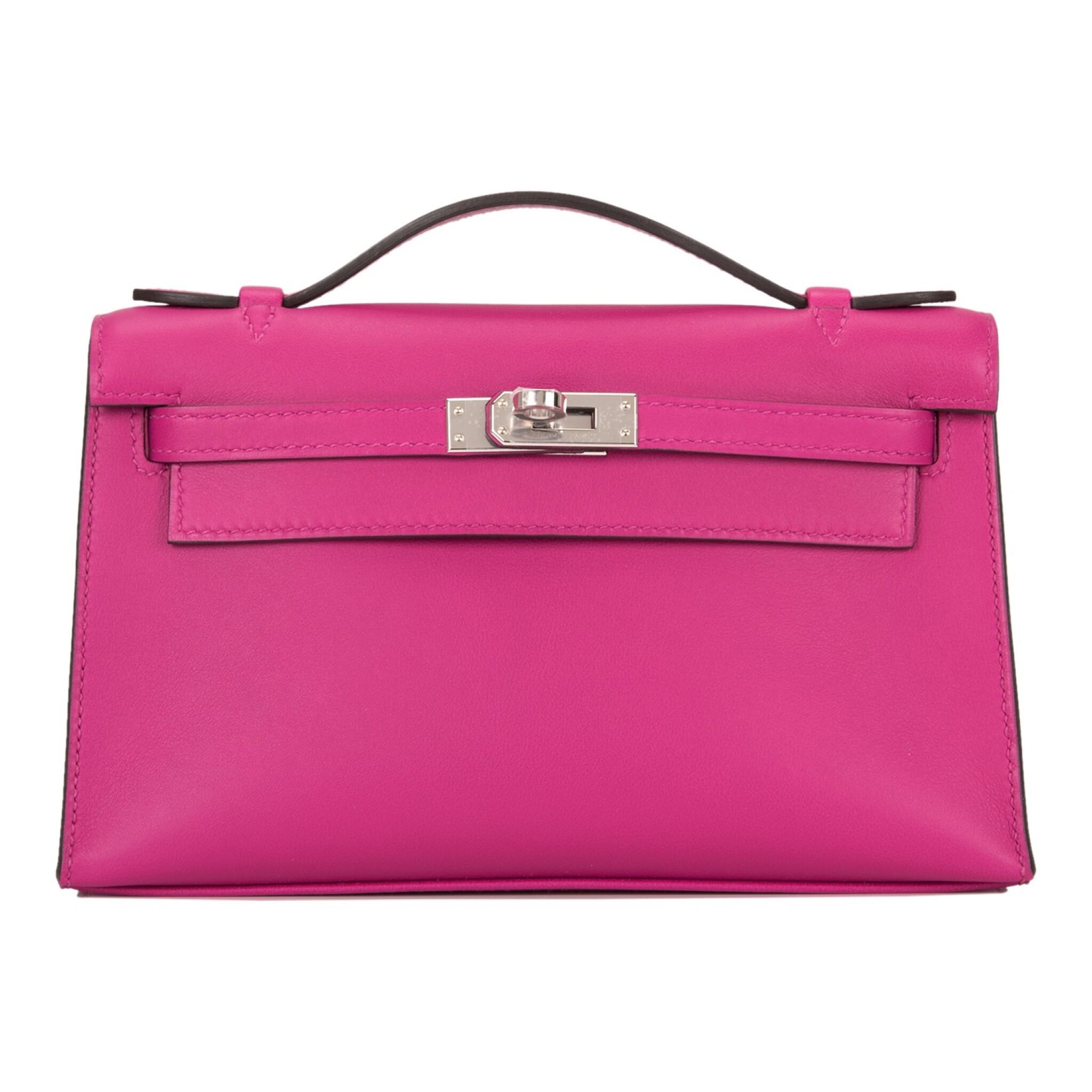 View full screen - View 1 of Lot 15. Hermès Rose Pourpre Swift Mini Kelly Pochette.