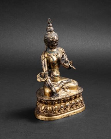 View 3. Thumbnail of Lot 48. Figure de Tara Blanche en cuivre doré repoussé Tibet, XVIIIE siècle | 西藏 十八世紀 鎏金銅白度母坐像 | A gilt-copper repoussé figure of the white Tara, Tibet 18th century.