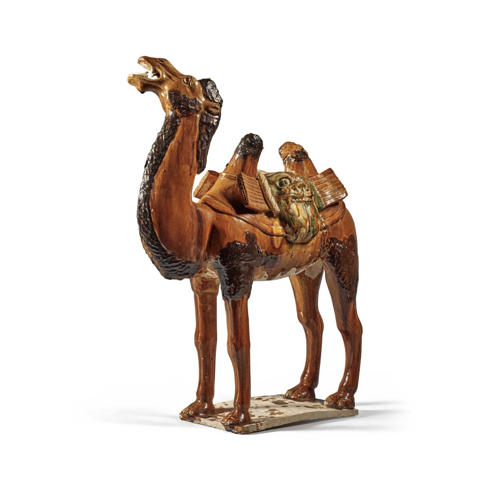 View full screen - View 1 of Lot 180. A sancai-glazed pottery figure of a camel, Tang dynasty   唐 三彩駱駝.