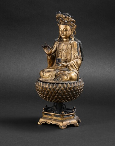 View 2. Thumbnail of Lot 39. Statue de Guanyin en bronze doré Dynastie Ming, XVIIE siècle | 明十七世紀 鎏金銅觀音菩薩坐像 | A large gilt-bronze figure of Guanyin on a lotus base, Ming Dynasty, 17th century.