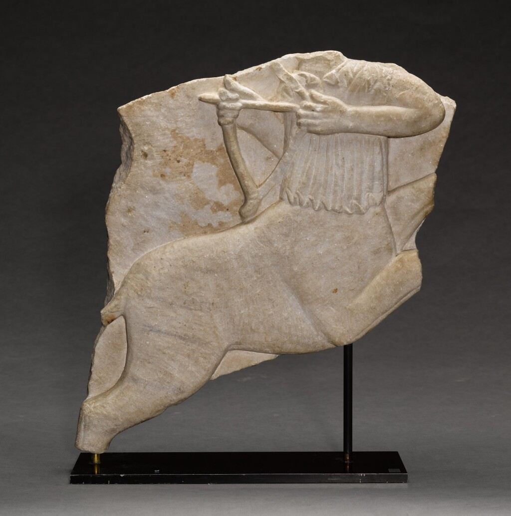 NORTHERN ITALIAN, CIRCA 11TH CENTURY | DOUBLE-SIDED RELIEF FRAGMENT FROM A BALUSTRADE PANEL WITH A SAGITTARIUS