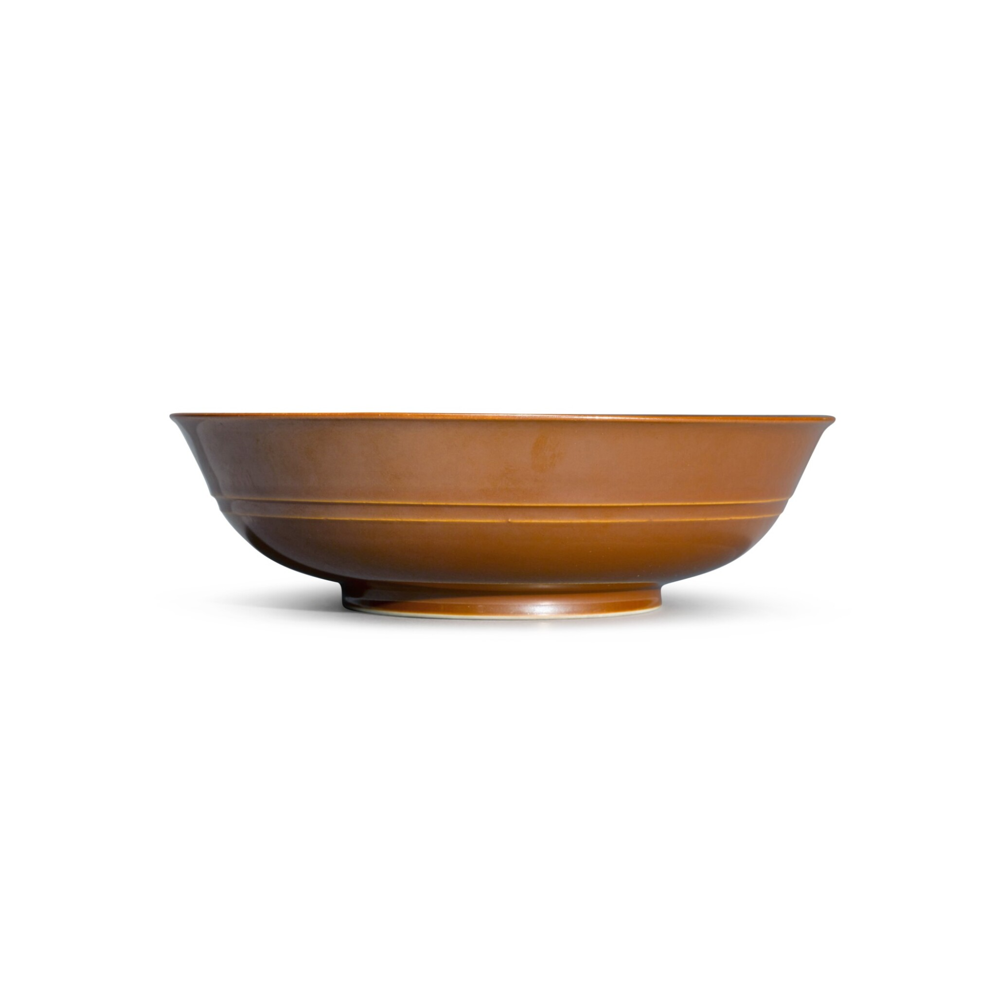 View full screen - View 1 of Lot 137. A cafe-au-lait-glazed bowl, Seal mark and period of Qianlong | 清乾隆 紫金釉弦紋盌 《大清乾隆年製》款.