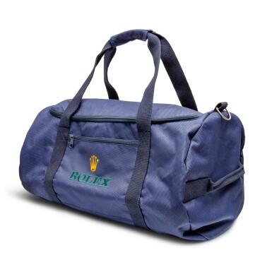 View 2. Thumbnail of Lot 8020. Rolex | A blue canvas duffle bag, Circa 2011 | 勞力士 | 藍色帆布手提袋,約2011年製.