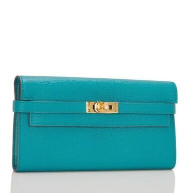 View 2. Thumbnail of Lot 23. Hermès Blue Paon Chevre Leather Kelly Longue Wallet.