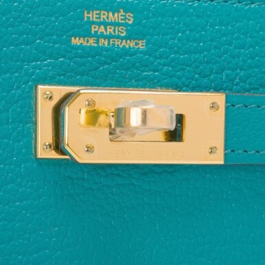 View 5. Thumbnail of Lot 23. Hermès Blue Paon Chevre Leather Kelly Longue Wallet.
