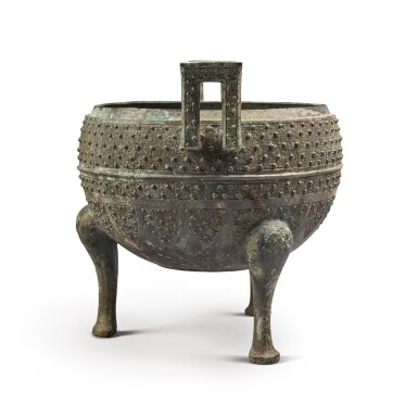 View 2. Thumbnail of Lot 19. An archaic bronze food vessel (Ding), Eastern Zhou dynasty | 東周 青銅交龍紋鼎.