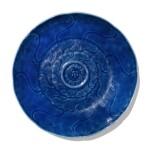 A carved blue-glazed dish, Qing dynasty, 18th century