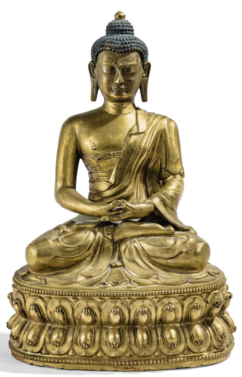 STATUETTE DE BOUDDHA EN ALLIAGE DE CUIVRE DORÉ REPOUSSÉ TIBET, XVIIIE SIÈCLE | 西藏 十八世紀 鎏金銅合金佛坐像 | A repoussé gilt copper-alloy figure of Buddha, Tibet, 18th century
