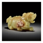 A LARGE YELLOW AND RUSSET JADE CARVING OF A MYTHICAL BEAST,  QING DYNASTY, QIANLONG PERIOD