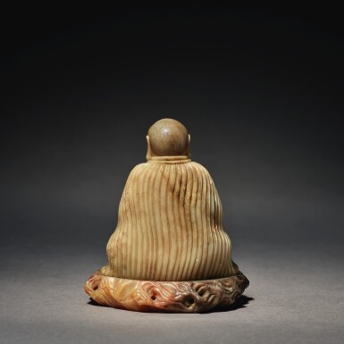View 2. Thumbnail of Lot 673. A SUPERB SOAPSTONE FIGURE OF A LUOHAN, ATTRIBUTED TO ZHOU BIN, 17TH / 18TH CENTURY.