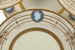 A SET OF EIGHT MINTONS PÂTE-SUR-PÂTE PLATES SLATE-BLUE AND IVORY-GROUND PLATES, 1915-21