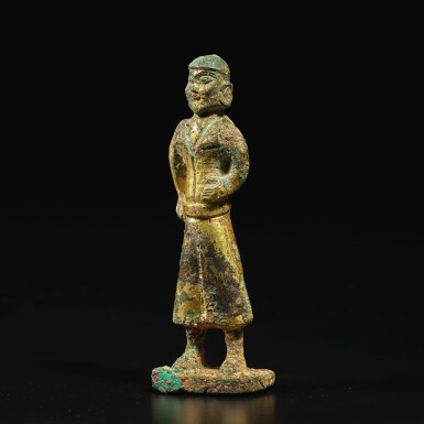 View 3. Thumbnail of Lot 582. A GILT-BRONZE FIGURE OF A FOREIGN MERCHANT,  TANG DYNASTY.