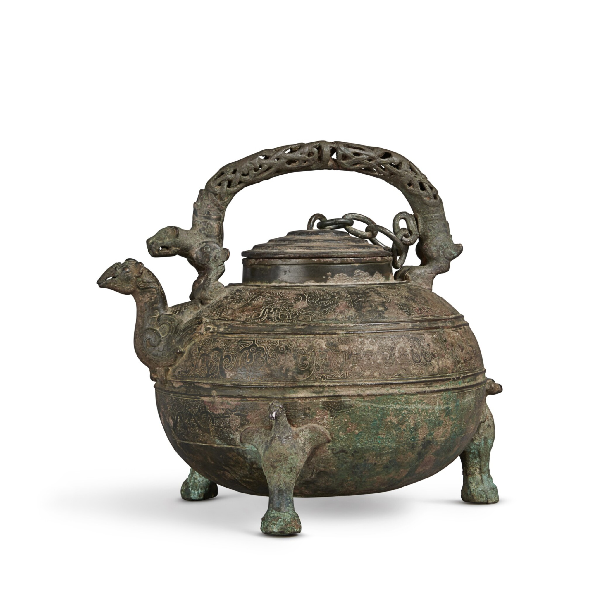 View full screen - View 1 of Lot 15. An archaic bronze wine vessel and cover (He), Eastern Zhou dynasty, Warring States period   東周 戰國 青銅獸紋盉.