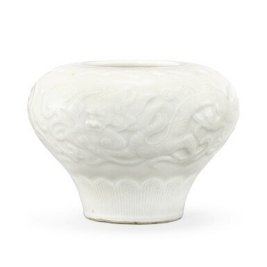 A MOULDED AND CARVED WHITE 'DRAGON' JARLET QING DYNASTY, 18TH CENTURY | 清十八世紀 白釉模印雲龍紋罐
