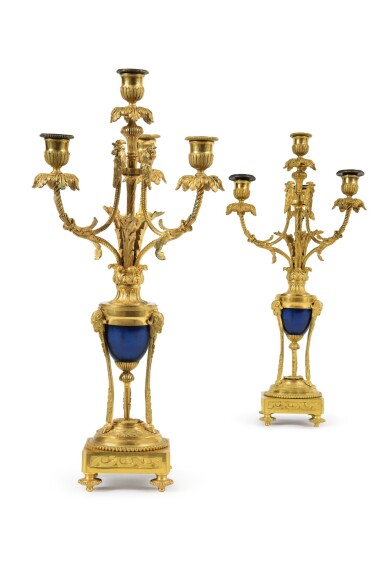 A PAIR OF LOUIS XVI STYLE GILT BRONZE AND BLUED STEEL FOUR-LIGHT CANDELABRA