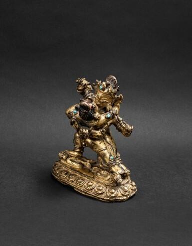 View 1. Thumbnail of Lot 35. Figure de Vajrahumkara en alliage de cuivre Tibet, XIVE siècle | 西藏 十四世紀 鎏金銅合金大威紅勝金剛立像 | A gilt-copper alloy figure of Vajrahumkara, Tibet, 14th century.