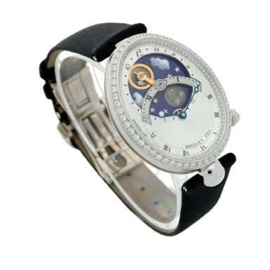 View 3. Thumbnail of Lot 107. Reference 8998 Reine De Naples A white gold and diamond-set automatic oval wristwatch with moon phases and 24-hour indication, Circa 2015.