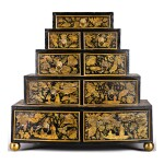 A REGENCY BLACK JAPANNED PENWORK GRADUATED TABLE CHEST OF DRAWERS, CIRCA 1815