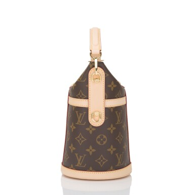 View 3. Thumbnail of Lot 55. Louis Vuitton Monogram Duffle Bag PM of Coated Canvas and Gold Tone Hardware.