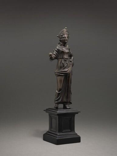 View 5. Thumbnail of Lot 205. AN ETRUSCAN BRONZE FIGURE OF A GODDESS, CIRCA 2ND CENTURY B.C..