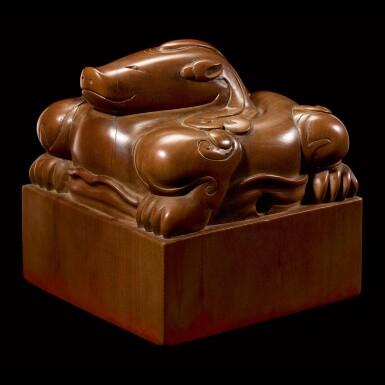 View 1. Thumbnail of Lot 3602. An exceptional imperial tanxiangmu 'Jingtian Qinmin' seal Qing dynasty, Kangxi period | 清康熙 康熙帝御寶檀香木異獸鈕方璽 印文:敬天勤民.