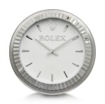 INDUCTA MANUFACTURE FOR ROLEX | A METALWORK WALL CLOCK, CIRCA 2010