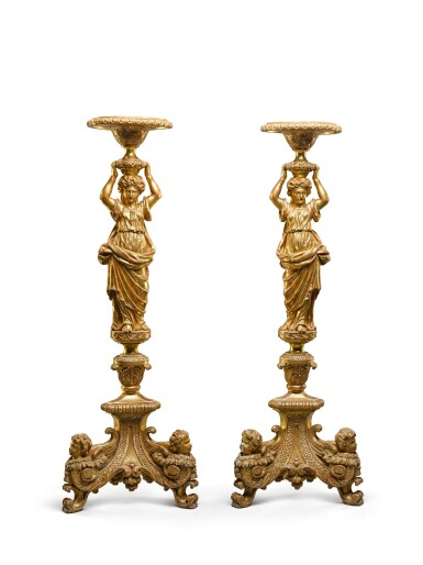 View 2. Thumbnail of Lot 30. A pair of George II carved giltwood torchères, second quarter 18th century, after a design by Alexis Loir.