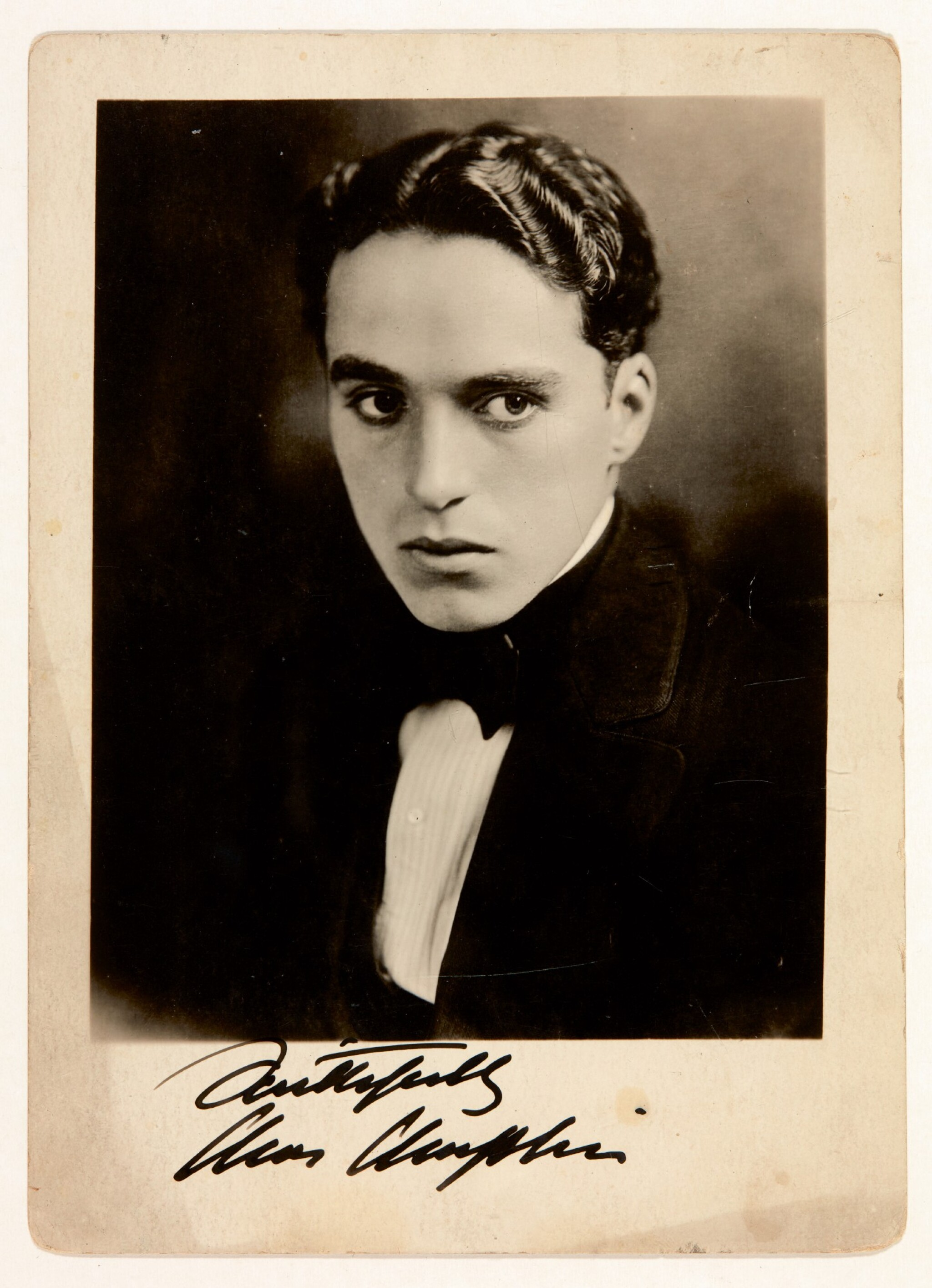 View full screen - View 1 of Lot 23. CHAPLIN | photographic portrait signed, c. 1910s.