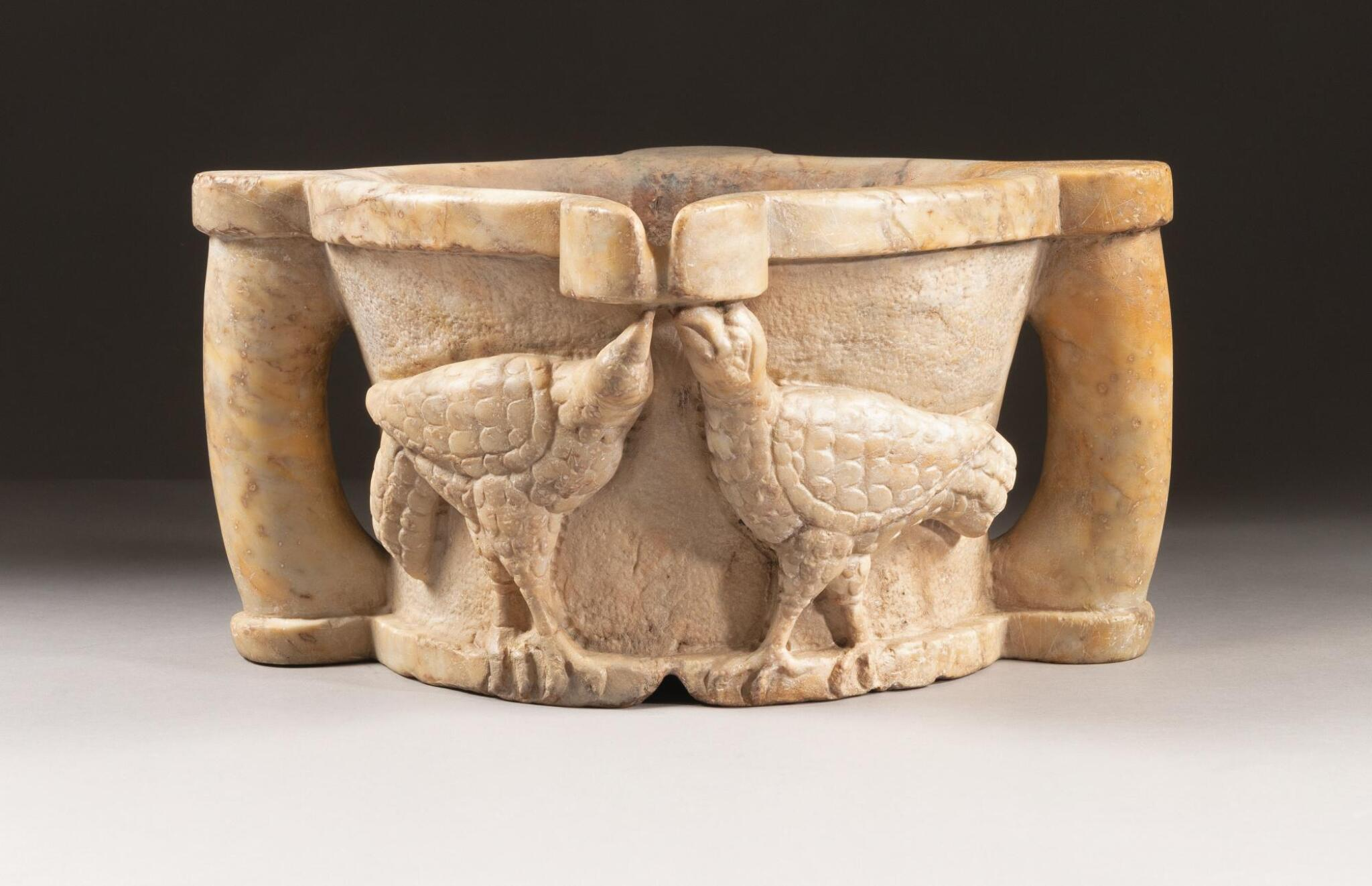 SOUTHERN ITALIAN, CIRCA 12TH CENTURY | MORTAR WITH AN EAGLE AND TWO DRINKING BIRDS