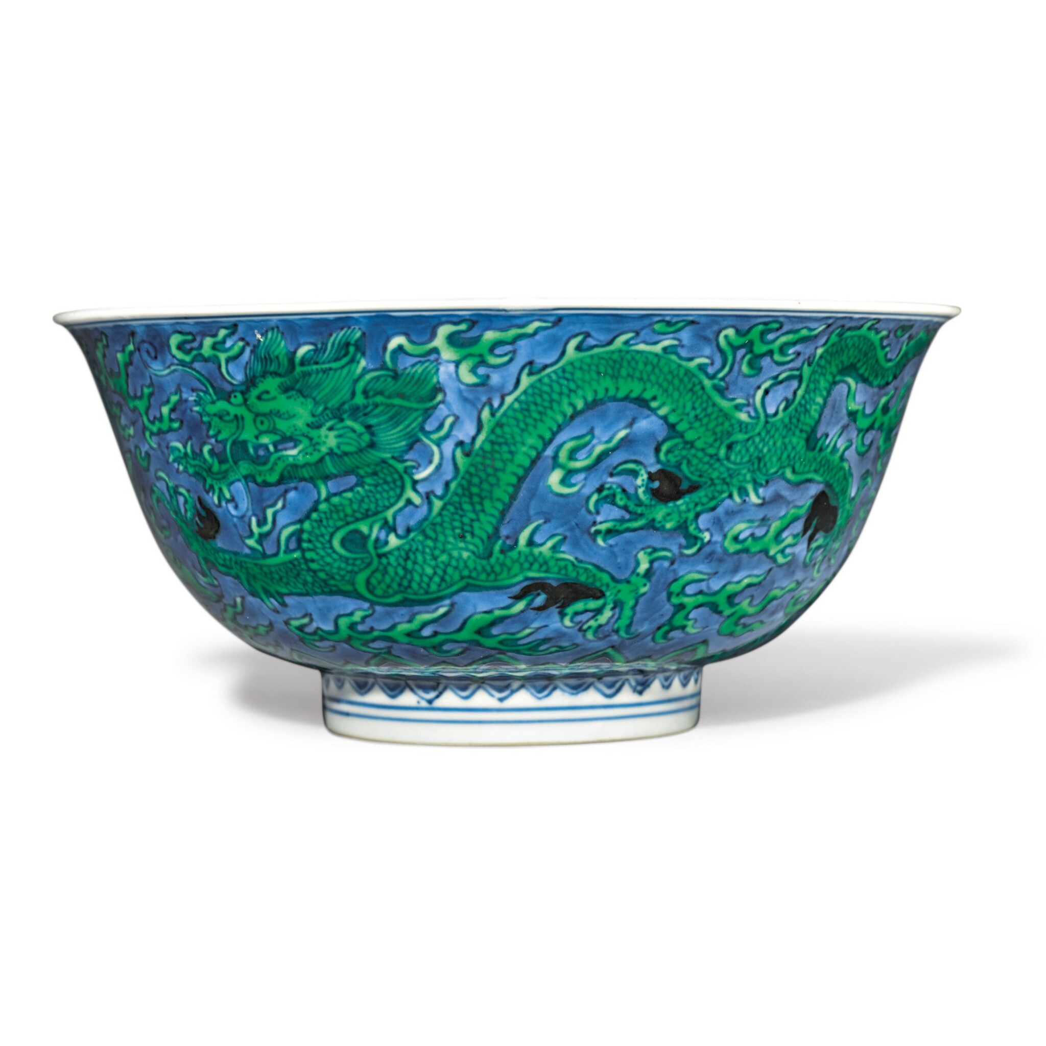 View full screen - View 1 of Lot 560. A BLUE-GROUND GREEN-ENAMELED 'DRAGON' BOWL,  KANGXI MARK AND PERIOD.