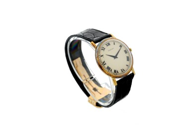View 3. Thumbnail of Lot 71. RETAILED BY CARTIER: A YELLOW GOLD WRISTWATCH, CIRCA 1970.