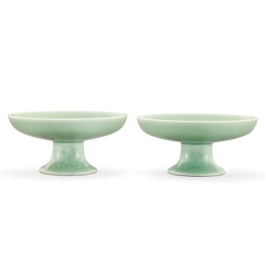 View 1. Thumbnail of Lot 111. A PAIR OF CELADON-GLAZED TAZZA DISHES SEAL MARKS AND PERIOD OF QIANLONG | 清乾隆 粉青釉花卉紋供盤一對 《大清乾隆年製》款.