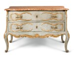 A SOUTH GERMAN CARVED, PARCEL-GILT AND PAINTED COMMODE