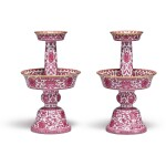 AN EXTREMELY RARE PAIR OF PUCE-ENAMELED 'BAJIXIANG' CANDLESTICKS,  QIANLONG SEAL MARKS AND PERIOD