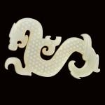 A SUPERB WHITE JADE S-SHAPED 'DRAGON AND PHOENIX' PENDANT EASTERN ZHOU DYNASTY, WARRING STATES PERIOD | 東周戰國時期 白玉曲體龍鳳珮